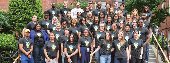 Group of educators with wearing Design Lab t-shirts