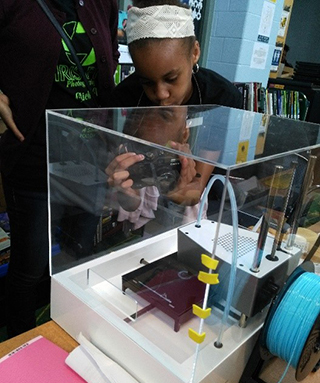 A female student checking out a science exhibit