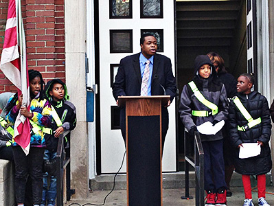 Students from the Garfield safety patrol stand outside.