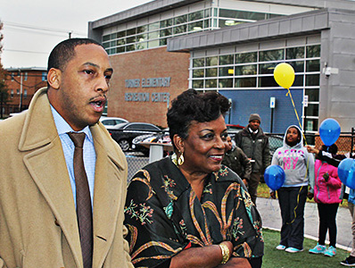 Eric Bethel, principal of Turner, joins Cora Barry, Mr. Barry's widow, at the school tribute.