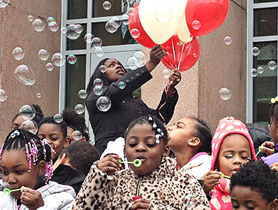 Students at Stanton stand outside their building and blew bubbles to honor Mr. Barry.