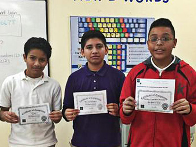 Students who completed the hour of code holding their certificates