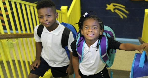Photo of children wearing backpacks