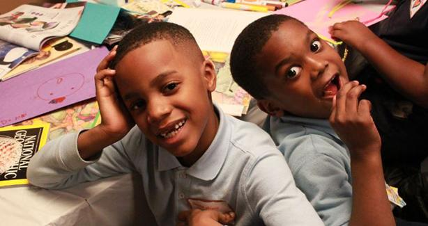 two young boys of color in a classroom