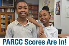 Photo of a young boy and girl with text: PARCC Scores Are In!
