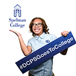 """Student with sign """"DCPS Goes to College"""" and logo for Spelman College"""
