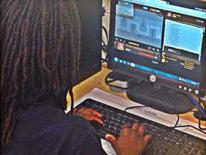 Ketcham student types HTML code.
