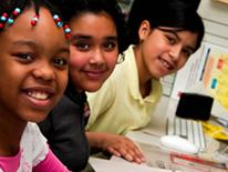 Photo of young girls in computer lab