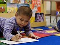 Photo of young boy working on assignment